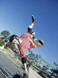 Skateboarder Performing a Handplant on a Ramp Photographic Print