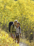 A Young Couple Hiking in the Woods Photographic Print