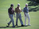 Three Senior Men Walking on a Golf Course Photographic Print