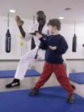 Young Man Teaching a Boy Martial Arts Photographic Print