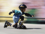 Boy on Rollerblades Crouching Photographic Print