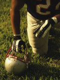 American Football Player Kneeling on the Field Fotografisk trykk