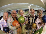 Portrait of a Group of Senior People Holding a Bowling Trophy at a Bowling Alley Photographic Print