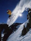 Airborne Snowboarder with Sunburst Reprodukcja zdjęcia