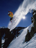 Airborne Snowboarder with Sunburst Photographic Print