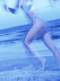 Side Profile of a Woman Running on the Beach Photographic Print