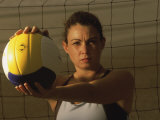 Young Woman Playing Beach Volleyball Photographic Print