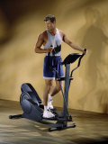 Young Man Exercising on an Exercise Machine Photographic Print