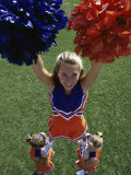 High Angle View of Cheerleaders Performing with Pom-Poms Photographic Print