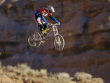 Side Profile of a Person on a Bicycle in Mid Air Photographic Print