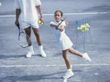 Girl Playing Tennis Under Supervision of a Coach Photographic Print
