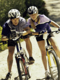 Portrait of a Young Couple Sitting on Bicycles Photographic Print