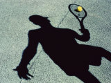 Shadow of a Male Tennis Player Playing Tennis Impresso fotogrfica