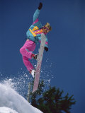 Snowboarder Performing Stunt Maneuver Photographic Print