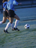 Two Teenage Girls Running for a Soccer Ball Photographic Print