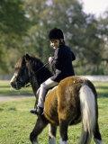 Girl Riding on a Pony Lámina fotográfica