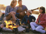 Parents And Their Children Sitting Around a Campfire Photographic Print