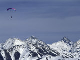 Paraglider Over Snowy Mountains Photographic Print