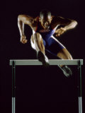 Portrait of a Young Man Jumping over a Hurdle Reproduction photographique