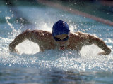 Young Man Swimming the Butterfly Stroke Photographie