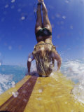 Female Surfer Doing a Headstand on a Surfboard Photographic Print