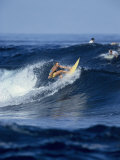 Female Surfer Riding a Wave Photographic Print
