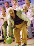 People Watching a Senior Man Bowling at a Bowling Alley Photographic Print
