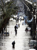 Residents Walk Through Floodwaters on Canal Street Photographic Print