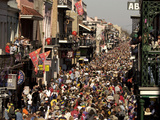 Revelers Pack the French Quarter's Famous Bourbon Street During the Annual Mardi Gras Celebration Photographic Print