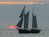 A Sailing Ship Sails During Sunset Towards the Harbor of Bremerhaven Photographic Print