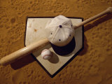 Baseball Bat with a Cap, and a Baseball on the Home Base Photographic Print