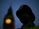 A British Police Officer Stands Guard Outside the Houses of Parliament Photographic Print