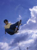Low Angle View of a Young Man Skateboarding Photographic Print