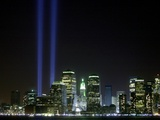 The Twin Lights Memorial Rises Above the New York City Skyline from the Waterfront Photographic Print
