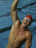 High Angle View of a Male Swimmer Raising His Hands in the Air Papier Photo