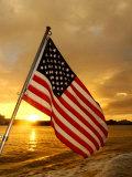 A Flag Waves Over Pearl Harbor as Dawn Breaks Fotodruck
