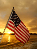 A Flag Waves Over Pearl Harbor as Dawn Breaks Photographic Print