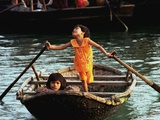 Sisters Who Live with Their Family on Halong Bay, Vietnam, Row Their Boat out to Greet Tourists Photographic Print