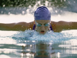 Young Woman Swimming the Butterfly Stroke Photographic Print