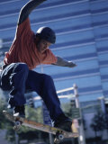 Young Man Skateboarding in Mid Air Photographic Print