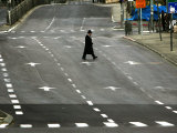 An Orthodox Israeli Jew Walks Across an Empty Road During the Sabbath Photographic Print