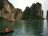 Boats Move Among the Craggy Islands of Halong Bay Photographic Print