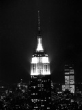 The Empire State Building Lights up at Night Photographic Print
