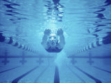 Young Woman Swimming Underwater Photographic Print