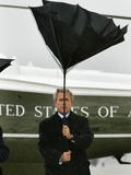President Bush Jokingly Holds His Wind-Blown Umbrella Upright Photographic Print