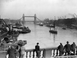 Pedestrians on London Bridge Watch Boats and Barges Being Unloaded Photographic Print