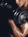 Young Man Exercising with Dumbbells Reproduction photographique