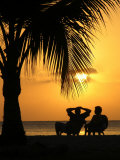 Tourists Relax Enjoying the Sunset on a Beach Photographic Print