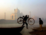 An Unidentified Cyclist Gets Down with His Cycle against the Backdrop of the Taj Mahal Photographic Print