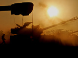 An Israeli Soldier Runs to Reload an Israeli Mobile Artillery Piece Photographic Print